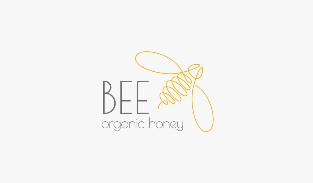 Logo d'art de ligne d'abeille